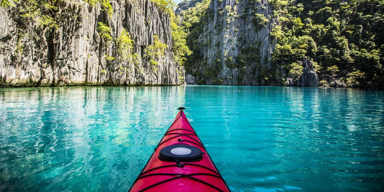Front view of a kayak in a beautiful turquoise lagoon in the Philippines.